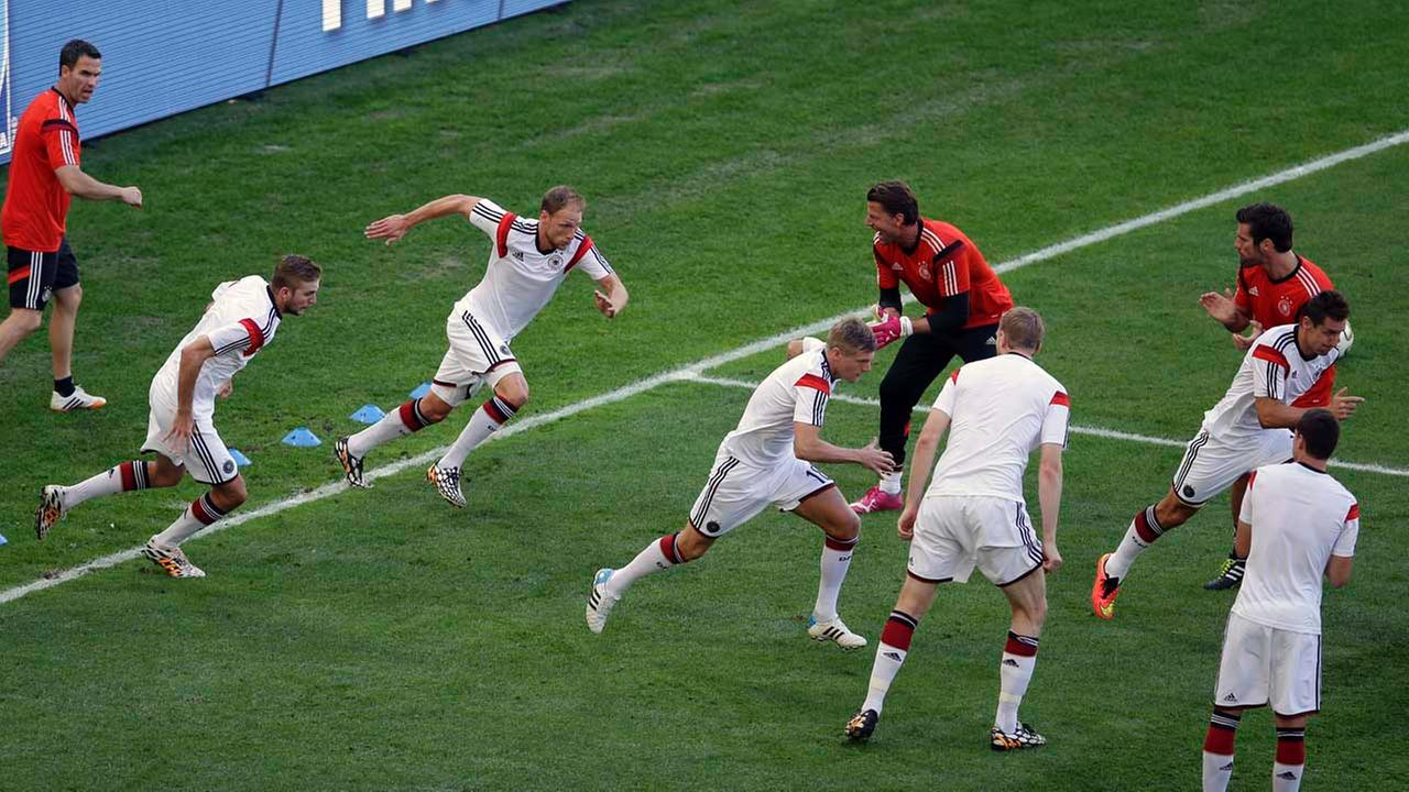 Germanys players run during warm-up before the World Cup final soccer match between Germany and Argentina at the Maracana Stadium in Rio de Janeiro, Brazil, Sunday, July 13, 2014.