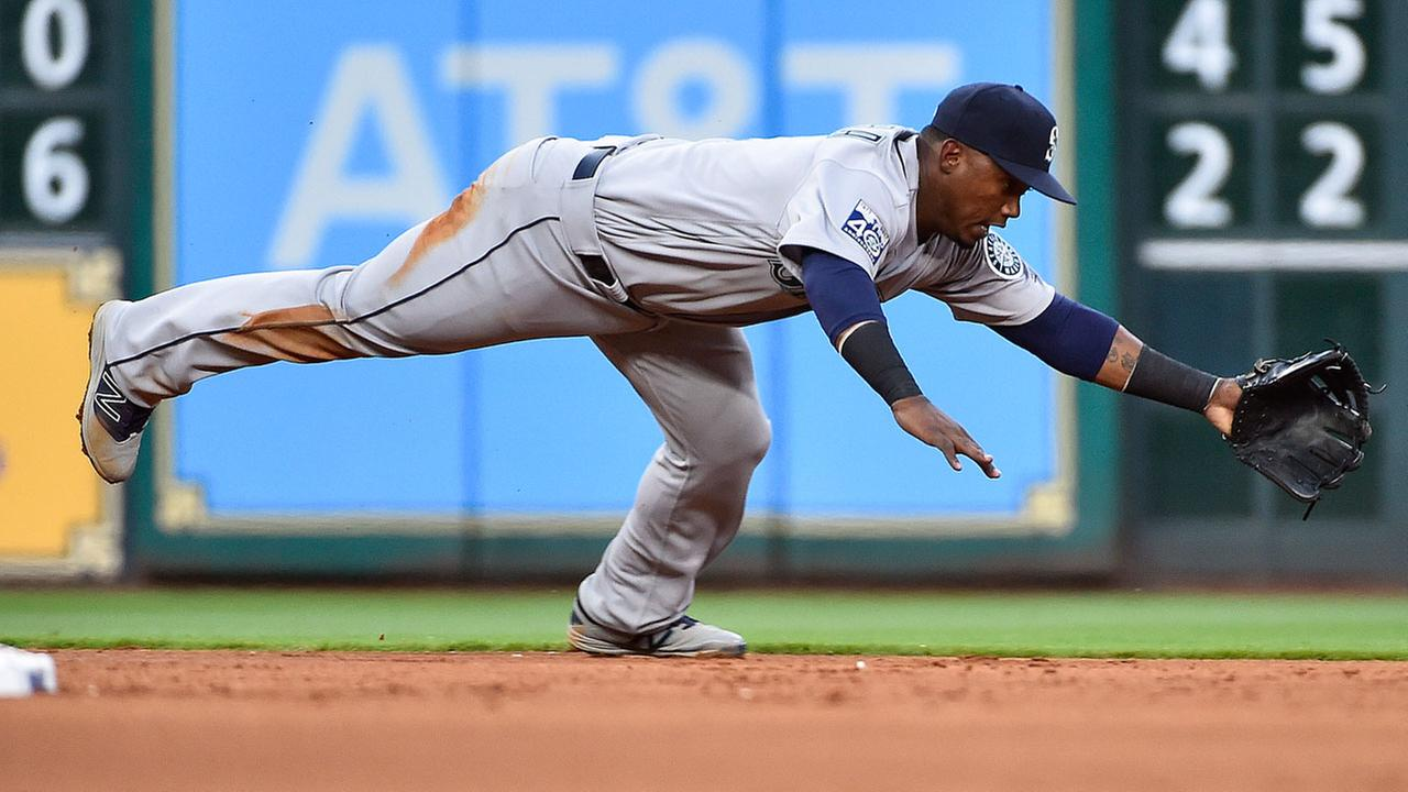 Seattle Mariners shortstop Jean Segura cant catch the ground ball of Houston Astros Alex Bregman in the second inning of the baseball game.AP Photo/Eric Christian Smith