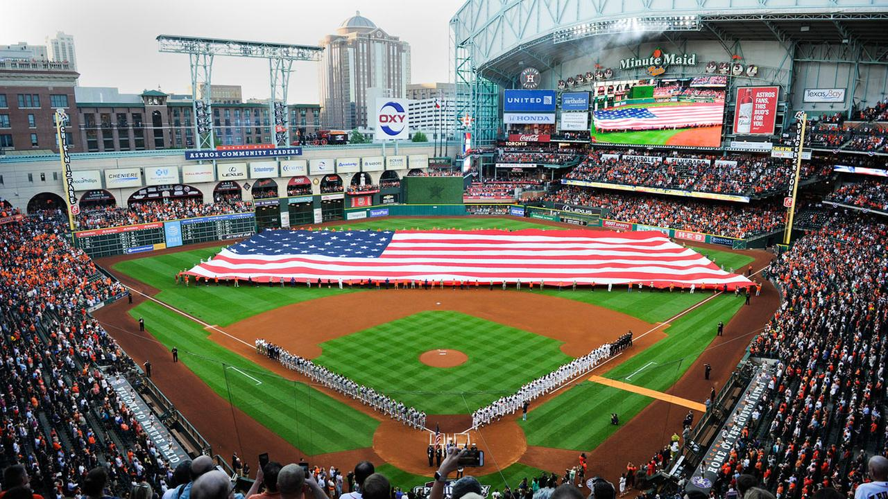 A flag of the United States in unfurled during the playing of the National Anthem before a baseball game between the Houston Astros and the Seattle Mariners.AP Photo/Eric Christian Smith