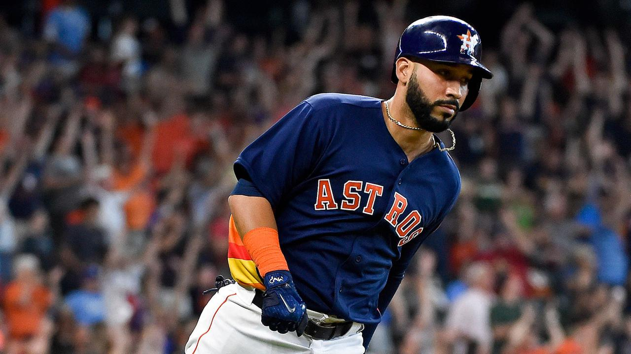 Houston Astros Marwin Gonzalez rounds the bases after hitting the game-tying two-run home run off Kansas City Royals starting pitcher Travis Wood in the seventh inning.