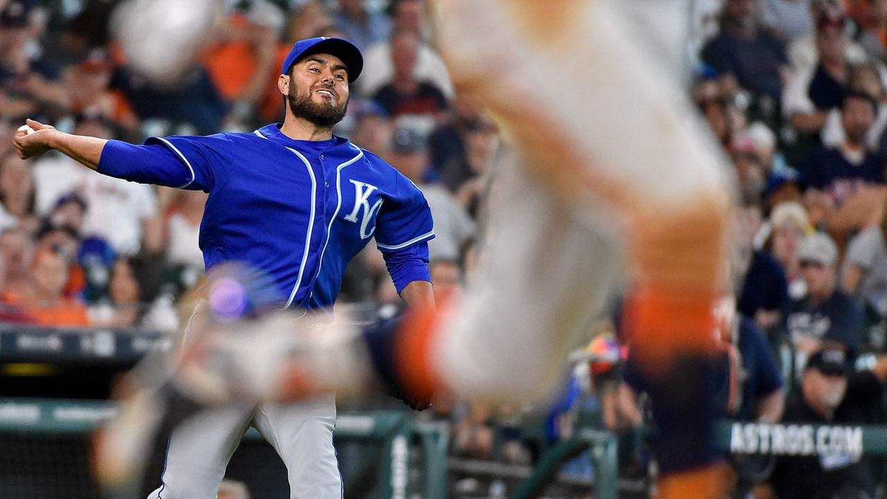 Kansas City Royals relief pitcher Joakim Soria, left, attempts to throw out Houston Astros Carlos Correa, right, in the 10th inning of a baseball game, Sunday, April 9, 2017.AP Photo/Eric Christian Smith