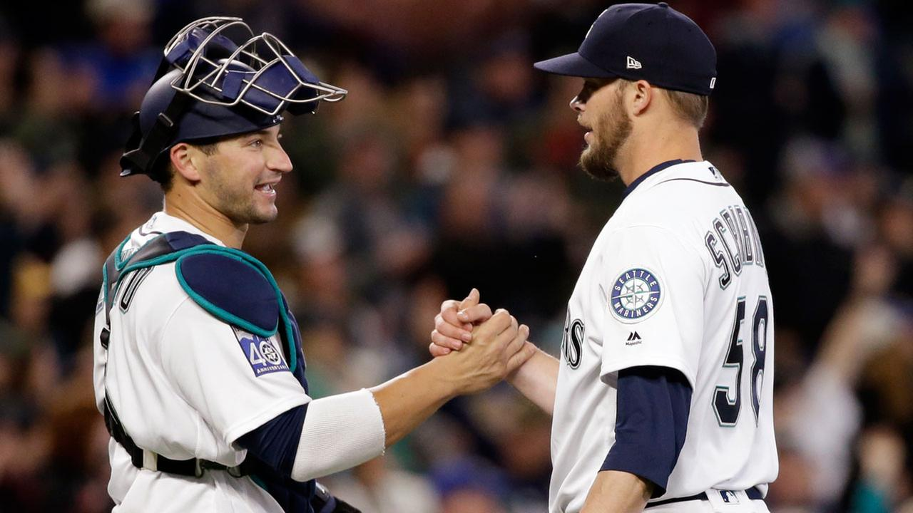 Seattle Mariners catcher Mike Zunino, left, and closing pitcher Evan Scribner share congratulation after the team beat the Houston Astros in a baseball game Monday, April 10, 2017.AP Photo/Elaine Thompson