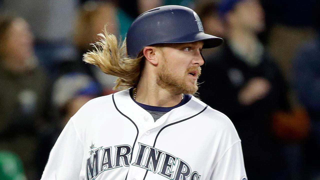 Seattle Mariners Taylor Motter looks back after scoring against the Houston Astros in a baseball game Monday, April 10, 2017, in Seattle.AP Photo/Elaine Thompson