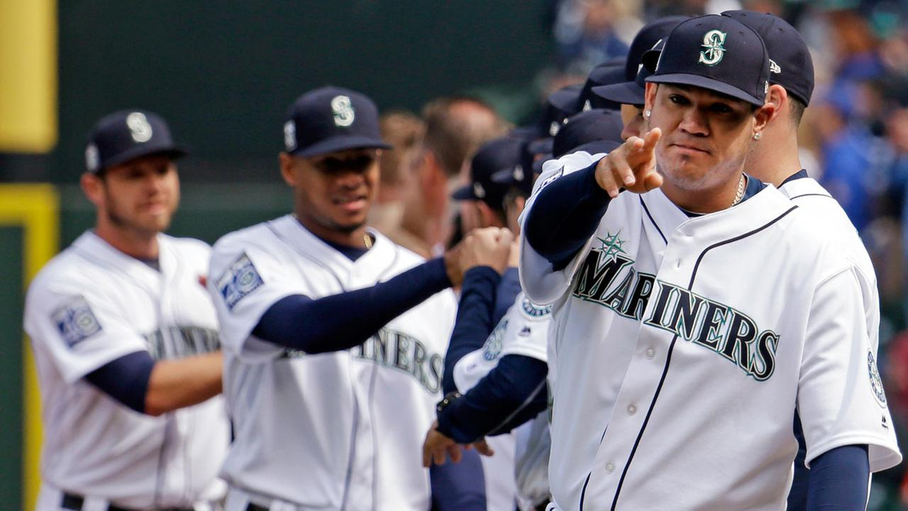 Seattle Mariners pitcher Felix Hernandez, right, motions during team introductions before a baseball game between the Mariners and Houston Astros Monday, April 10, 2017.AP Photo/Elaine Thompson