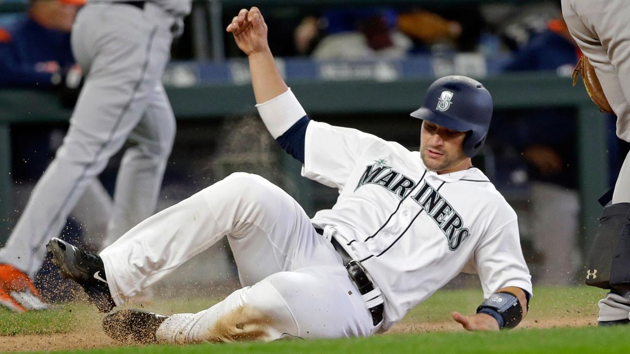 Seattle Mariners Mike Zunino scores against theHouston Astros in a baseball game Monday, April 10, 2017, in Seattle. The game is the home opener for the Mariners.AP Photo/Elaine Thompson