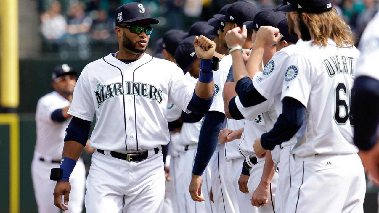 Robinson Cano greets teammates before a baseball game between the Mariners and Houston Astros Monday, April 10, 2017, in Seattle. The game is the home opener for the Mariners.AP Photo/Elaine Thompson