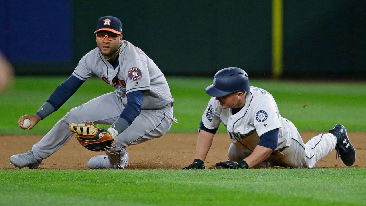 Houston Astros first baseman Yuli Gurriel, left, looks to the infield after tagging out Seattle Mariners Kyle Seager in a rundown between first and second bases.AP Photo/Ted S. Warren