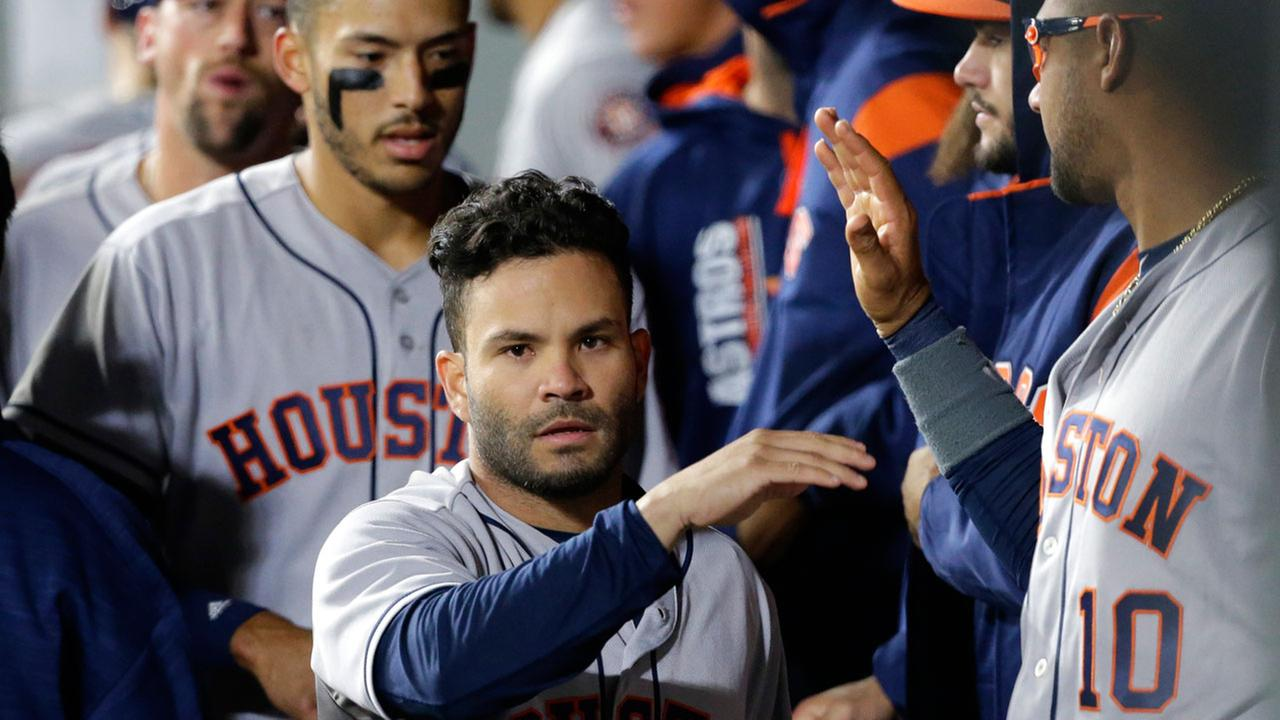 Houston Astros Jose Altuve, center, is greeted in the dugout after he scored against the Seattle Mariners during the ninth inning of a baseball game Tuesday, April 11, 2017.AP Photo/Ted S. Warren