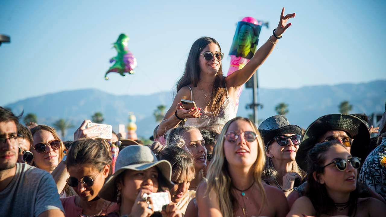 Festival goers seen at Coachella Music and Arts Festival at the Empire Polo Club on Friday, April 14, 2017, in Indio, Calif. (Photo by Amy Harris/Invision/AP)