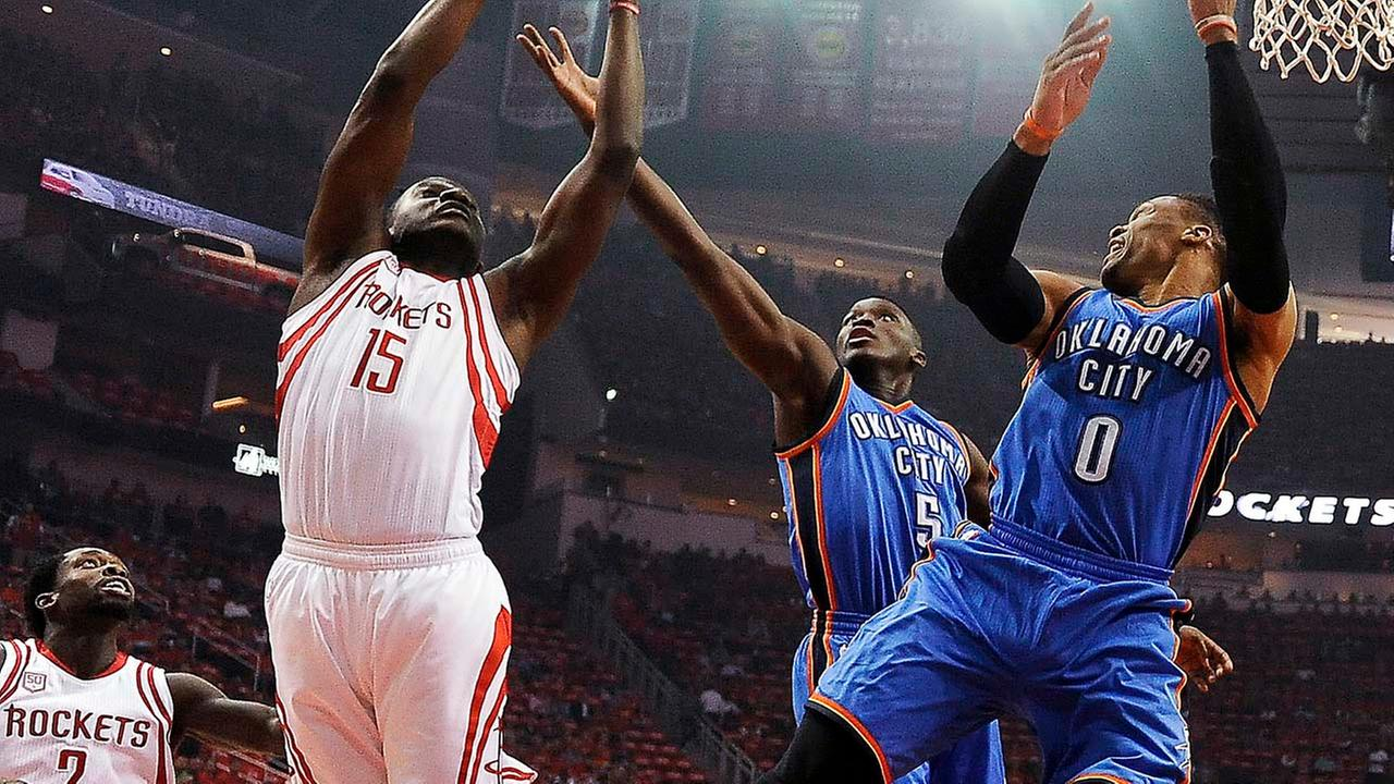 Houston Rockets forward Montrezl Harrell (5) grabs a rebound over Oklahoma City Thunder guards Victor Oladipo (5) and Russell Westbrook during the first half in Game 2.Eric Christian Smith