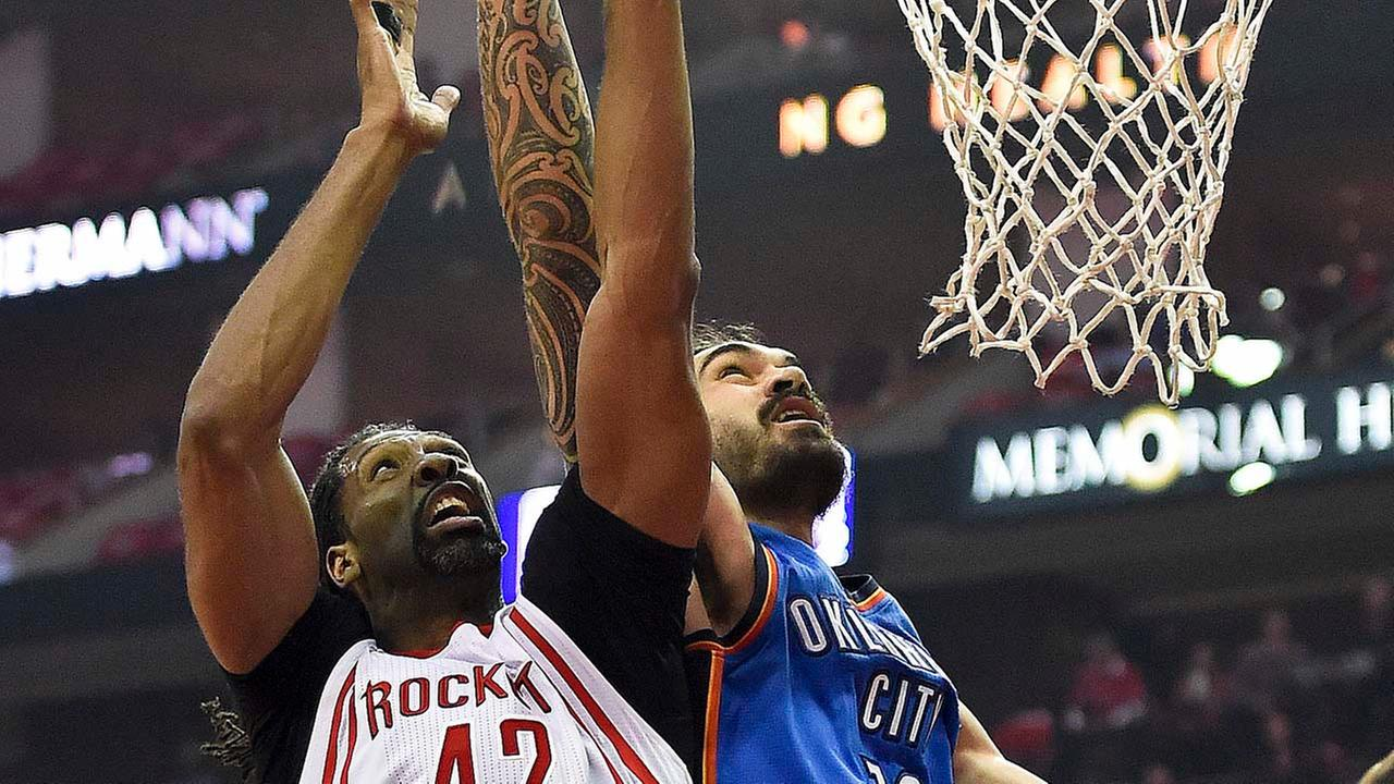 Houston Rockets center Nene Hilario (42) and Oklahoma City Thunder center Steven Adams (12) go up for a rebound during the first half in Game 2.Eric Christian Smith