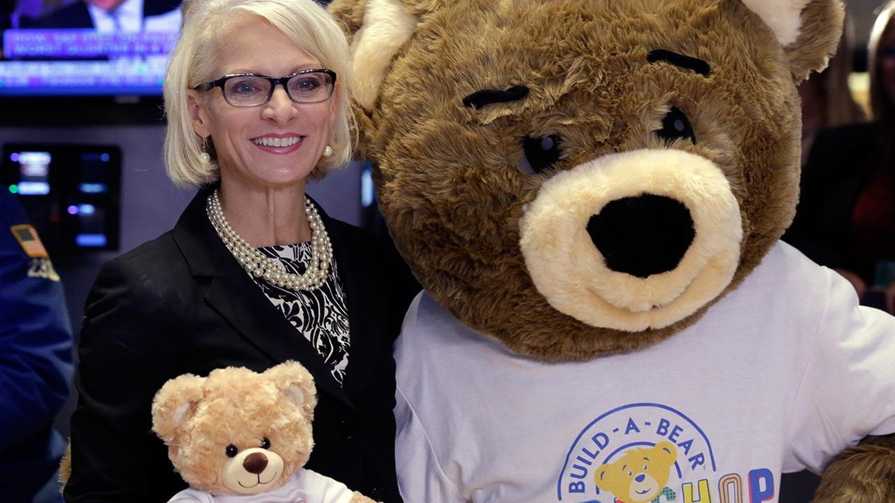Build-A-Bear Workshop CEO Sharon Price John, poses for photos on the floor of the New York Stock Exchange after ringing opening bell, to highlight National Teddy Bear Day