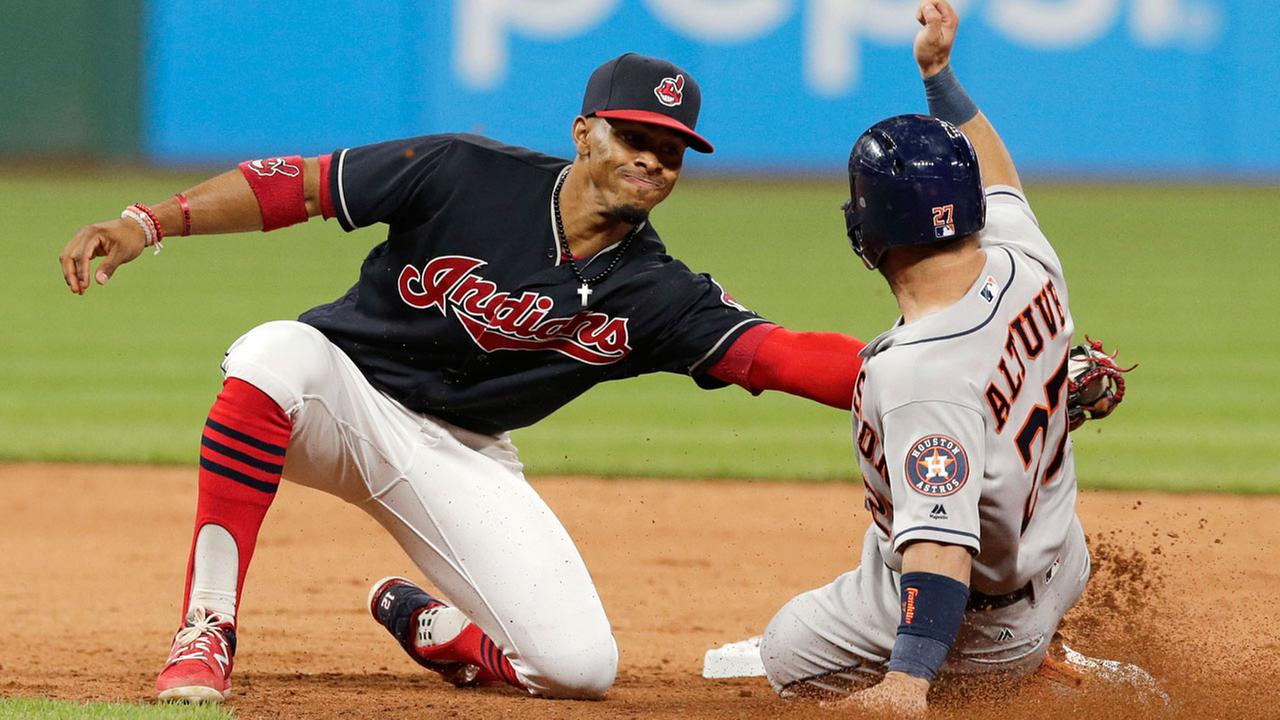 Cleveland Indians Francisco Lindor tags out Houston Astros Jose Altuve at second base on a steal attempt during the ninth inning of a baseball game, Thursday, April 27, 2017.