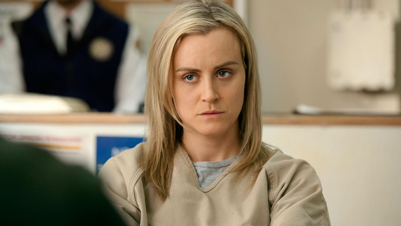 This image released by Netflix shows Taylor Schilling in a scene from Orange is the New Black.