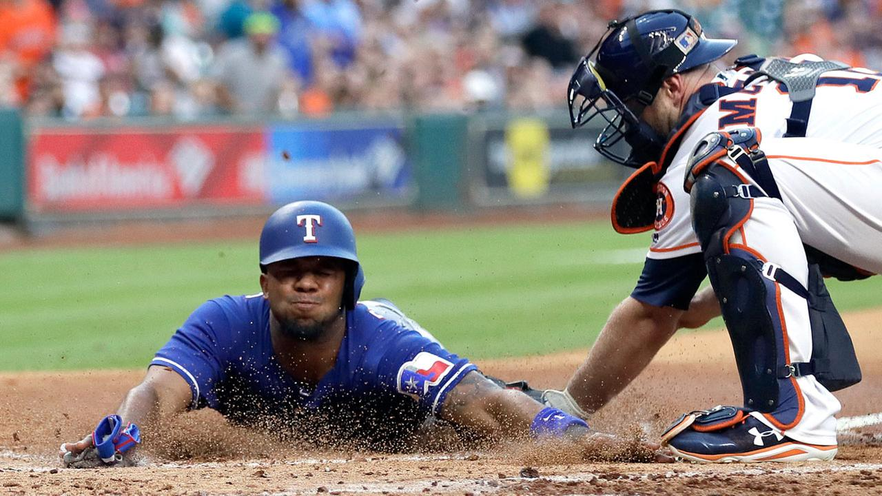 Texas Rangers Elvis Andrus, left, is tagged out by Houston Astros catcher Brian McCann while trying to score during the second inning of a baseball game, Monday, May 1, 2017.