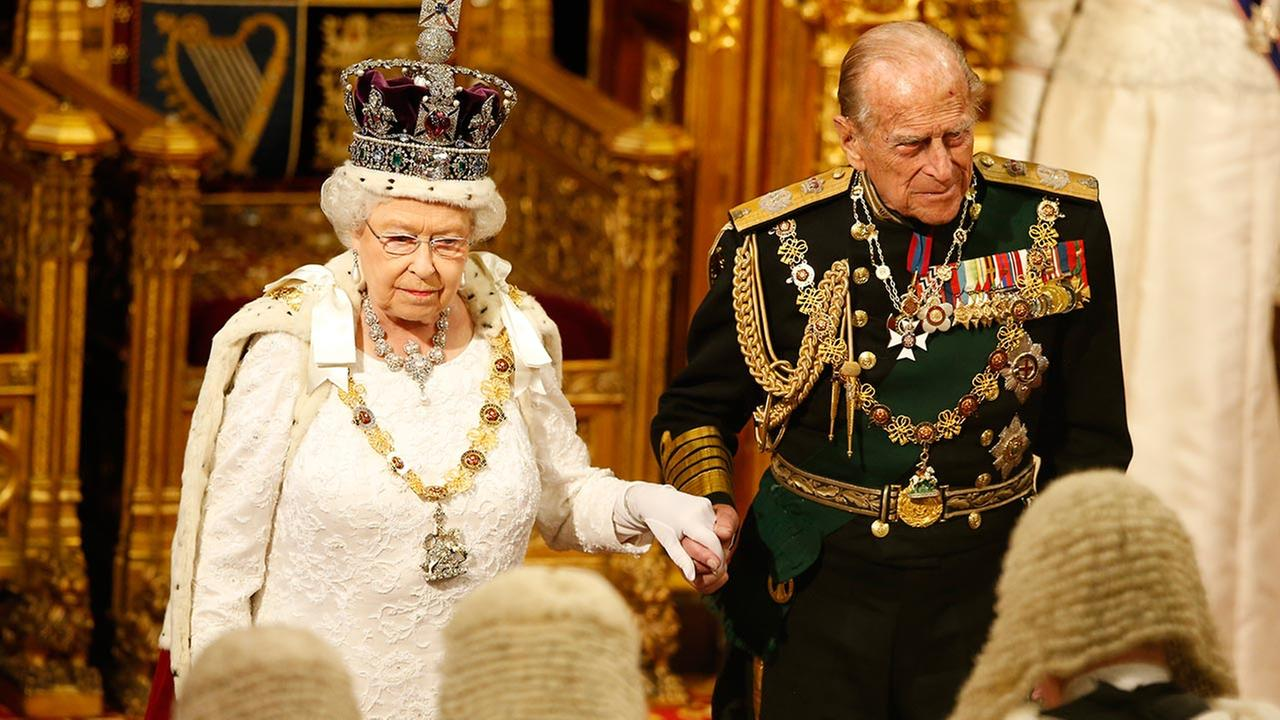 Britains Queen Elizabeth II with Prince Phillip look at the assembled lawmakers after she read the Queens Speech in London, Wednesday, May, 18, 2016.