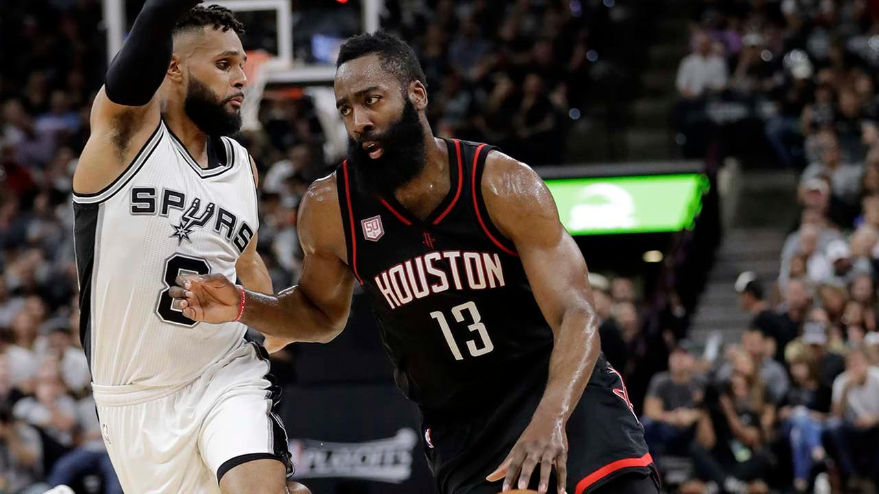 San Antonio Spurs Patty Mills (8) defends as Houston Rockets guard James Harden (13) advances the ball up court during the first half of Game 5. (AP Photo/Eric Gay)