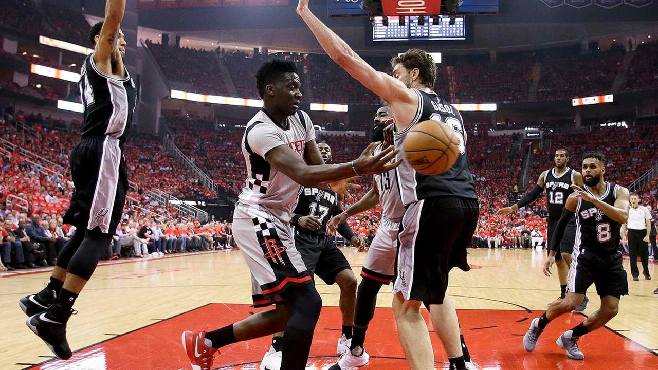 Houston Rockets center Clint Capela passes the ball around San Antonio Spurs center Pau Gasol during the first half in Game 6
