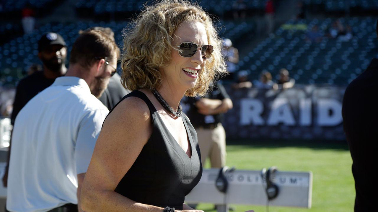 NFL announcer Beth Mowins walks on the field before an NFL preseason football game between the Oakland Raiders and the St. Louis Rams in Oakland, Calif., Friday, Aug. 14, 2015.