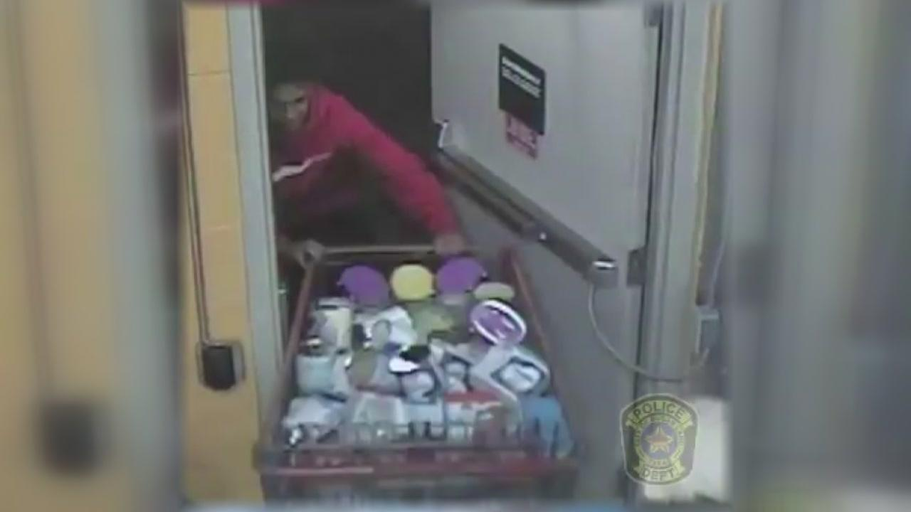 Surveillance video shows suspects stealing two shopping carts full of baby formula from HEB