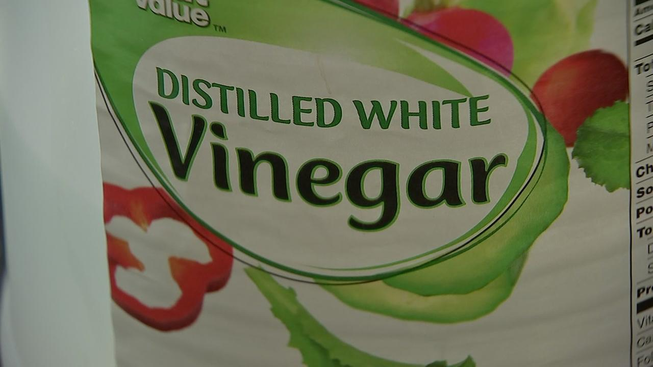 Vinegar becomes a multi-purpose cleaning tool in the kitchen.
