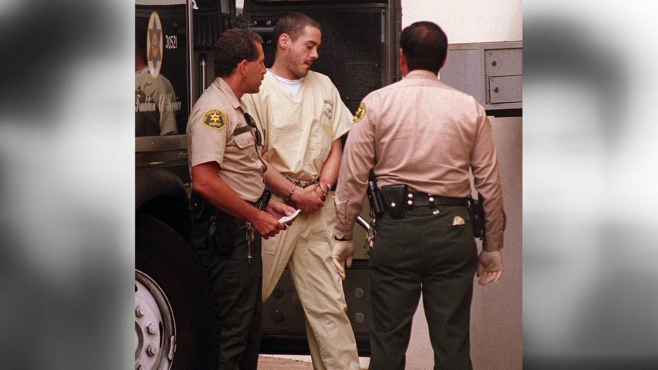 A handcuffed Robert Downey Jr. arrives at the courthouse in Malibu on July 22, 1996. Downey entered innocent pleas through his attorney on drug and weapons charges.