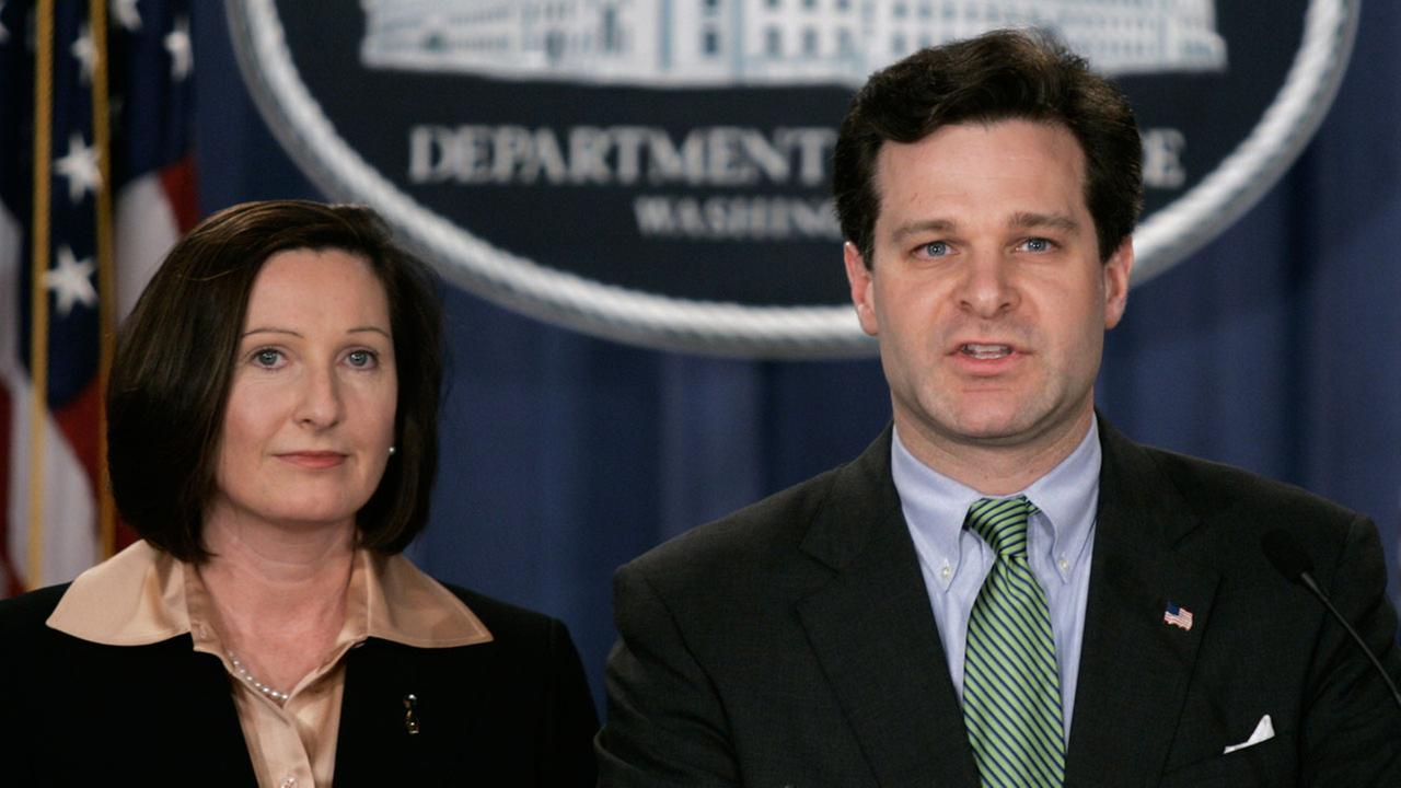 FILE - Assistant Attorney General, Christopher Wray, right, and Director of the Executive Office for U.S. Attorneys, Mary Beth Buchanan, hold a press conference, in January 2005.