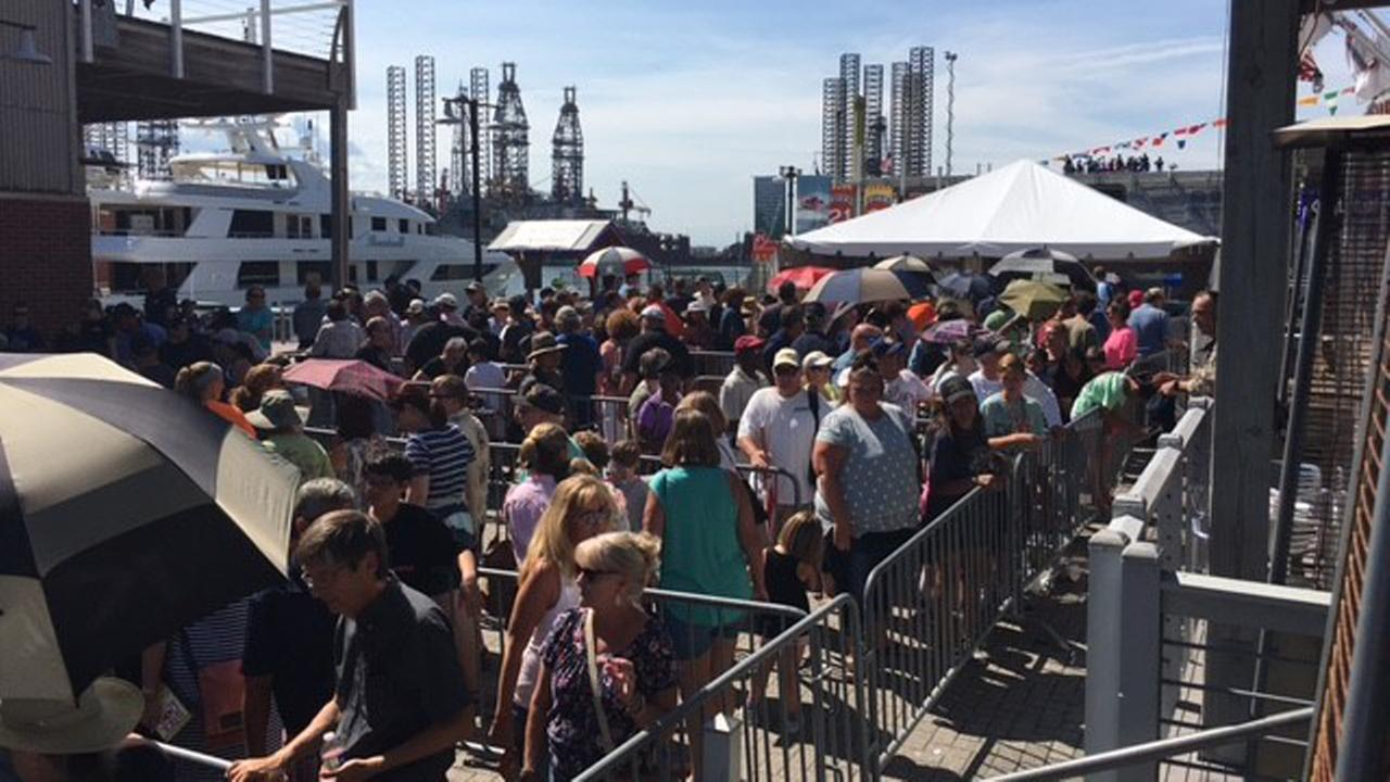 Tourists wait to board the USS Gabrielle Giffords for a tour.