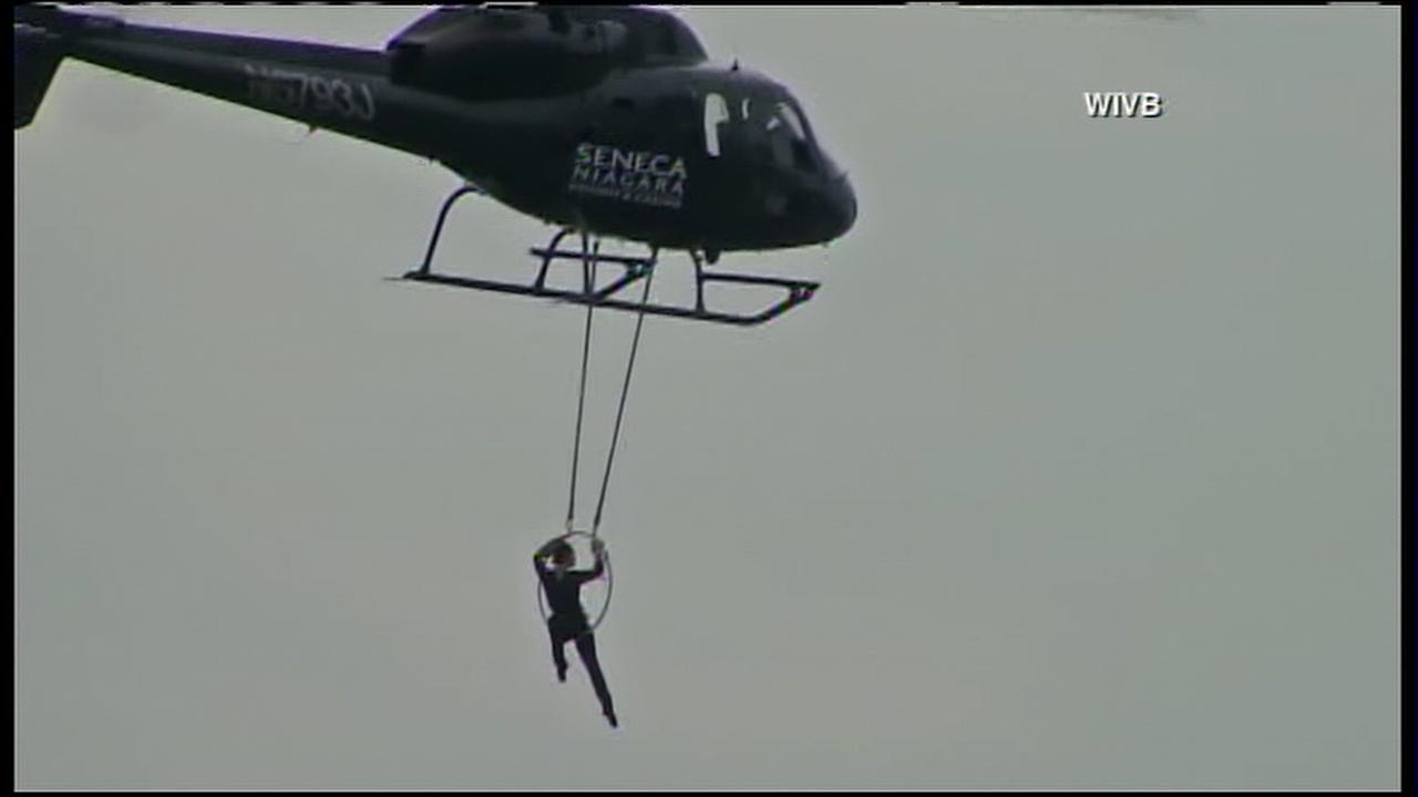 Acrobat Erendira Wallenda hangs by teeth from helicopter above Niagara Falls