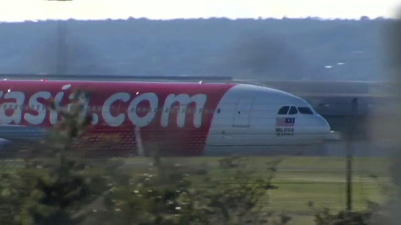 Air Asia flight experiences engine seizure causing severe shaking and terrifying passengers.
