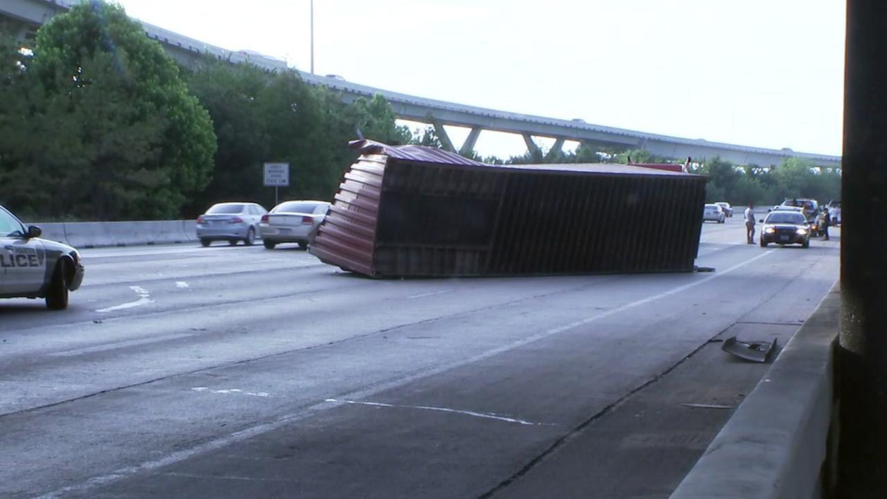 18-wheeler loses its shipping container when it slammed into an underpass on I-10 Katy Fwy.