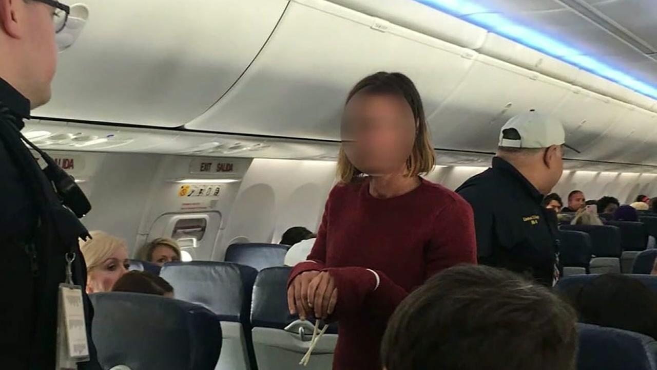 Southwest Passenger Tries to Open Emergency Exit In flight