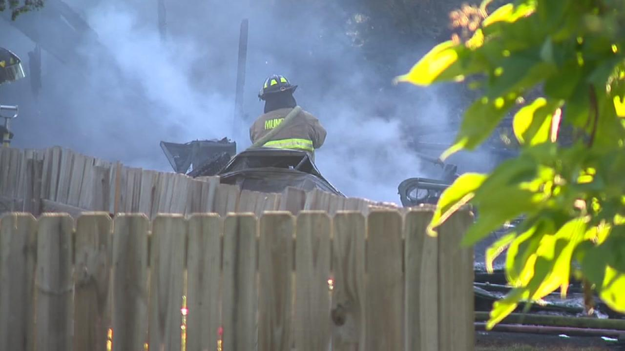 Man battling wasps burns down garage