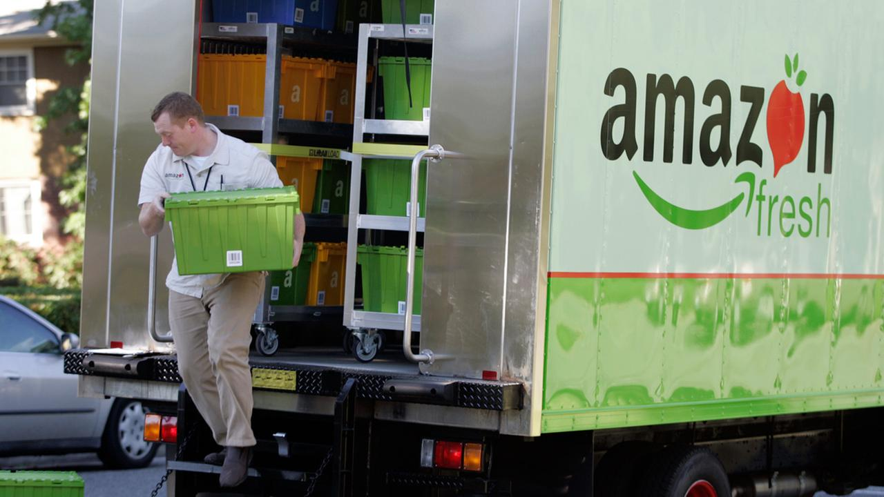 Amazon Fresh delivery man Tim Wilkie prepares a grocery order for delivery to a residence on Mercer Island, Wash., Thursday, Aug. 23, 2007.