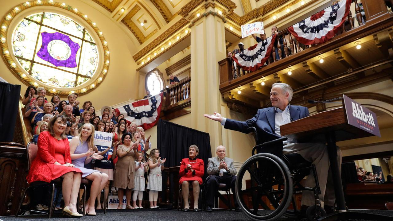 Texas Gov. Greg Abbott, right, points to his wife Cecilia, left, and daughter, Audrey, during an event where he announced his bid for re-election, Friday, July 14, 2017.