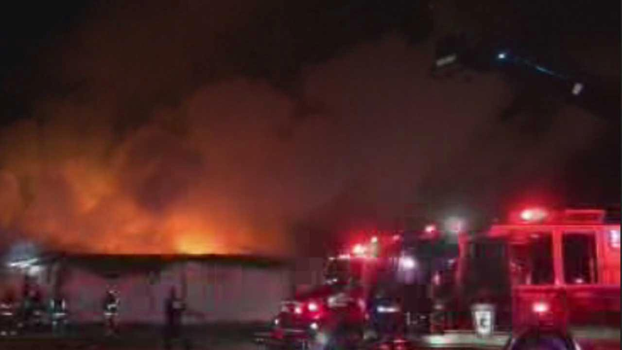 The thrift store roof seen engulfed in flames in Porter, TX.
