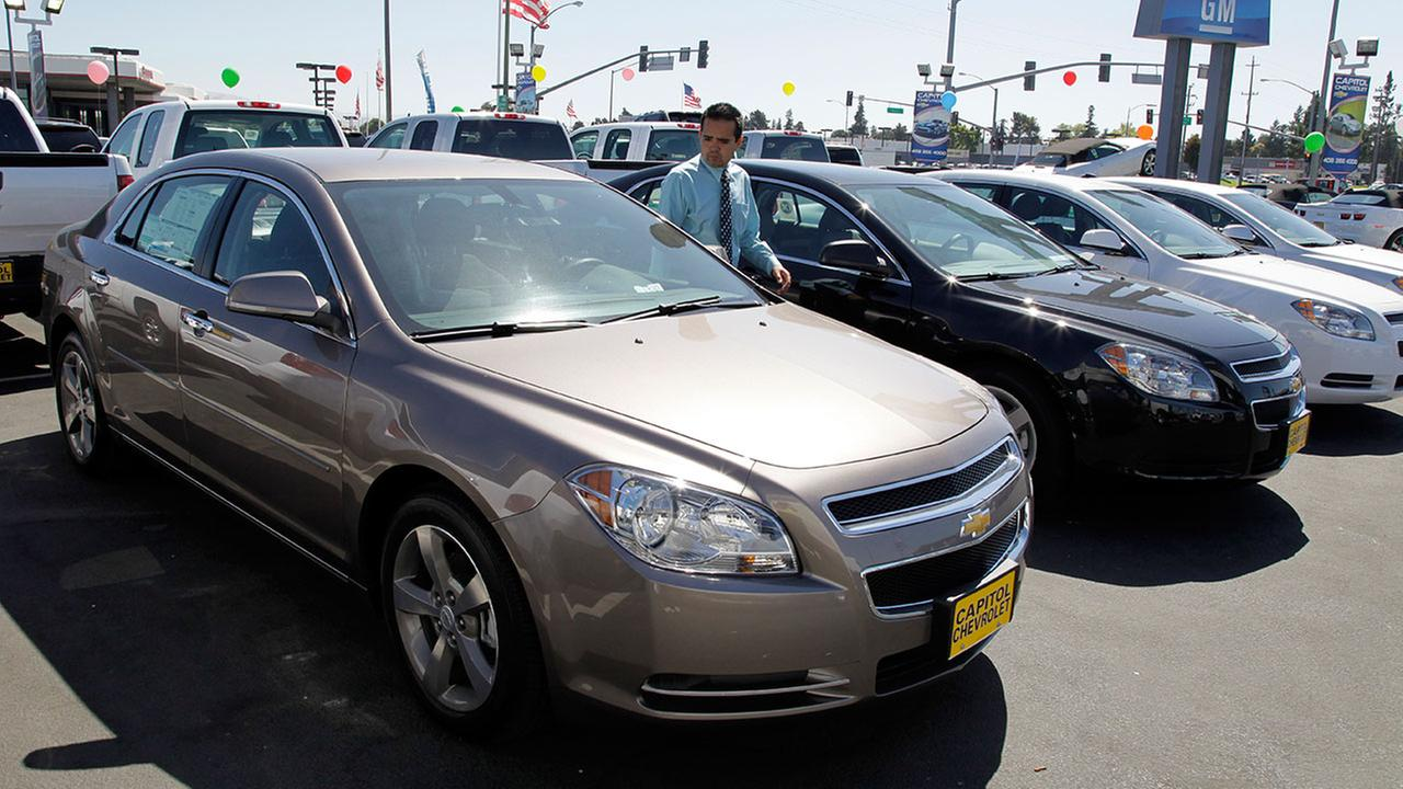 In this Aug. 30, 2011 file photo, 2011 Chevrolet Malibus are lined up at a car dealership in San Jose, Calif.
