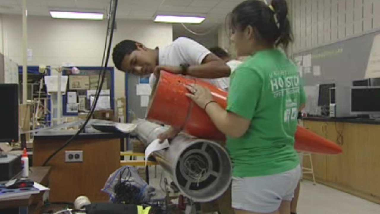 Booker T. Washington students assemble rocket model