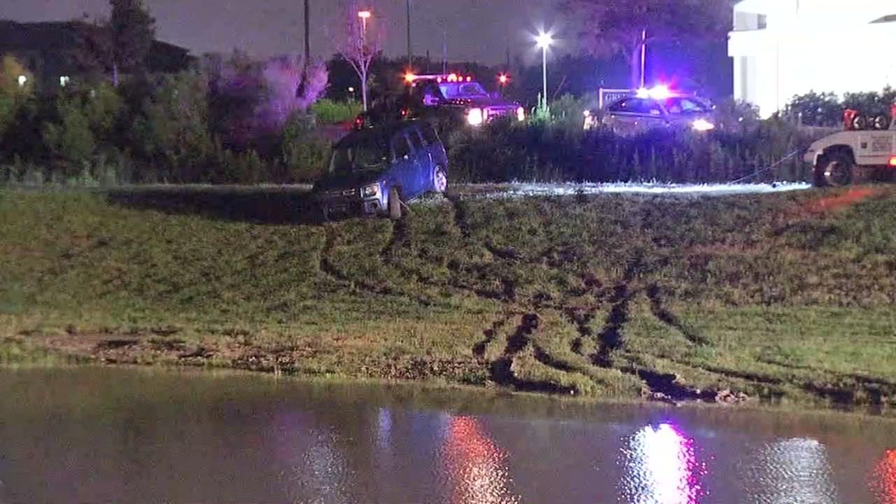 Woman and two children escape vehicle that ended up in retention pond.