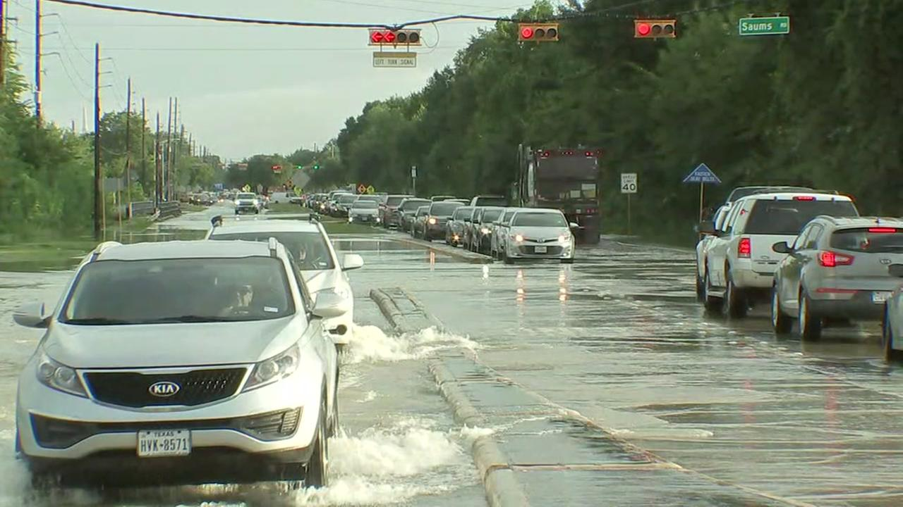 Water slowly receding on Greenhouse Road at Saums.