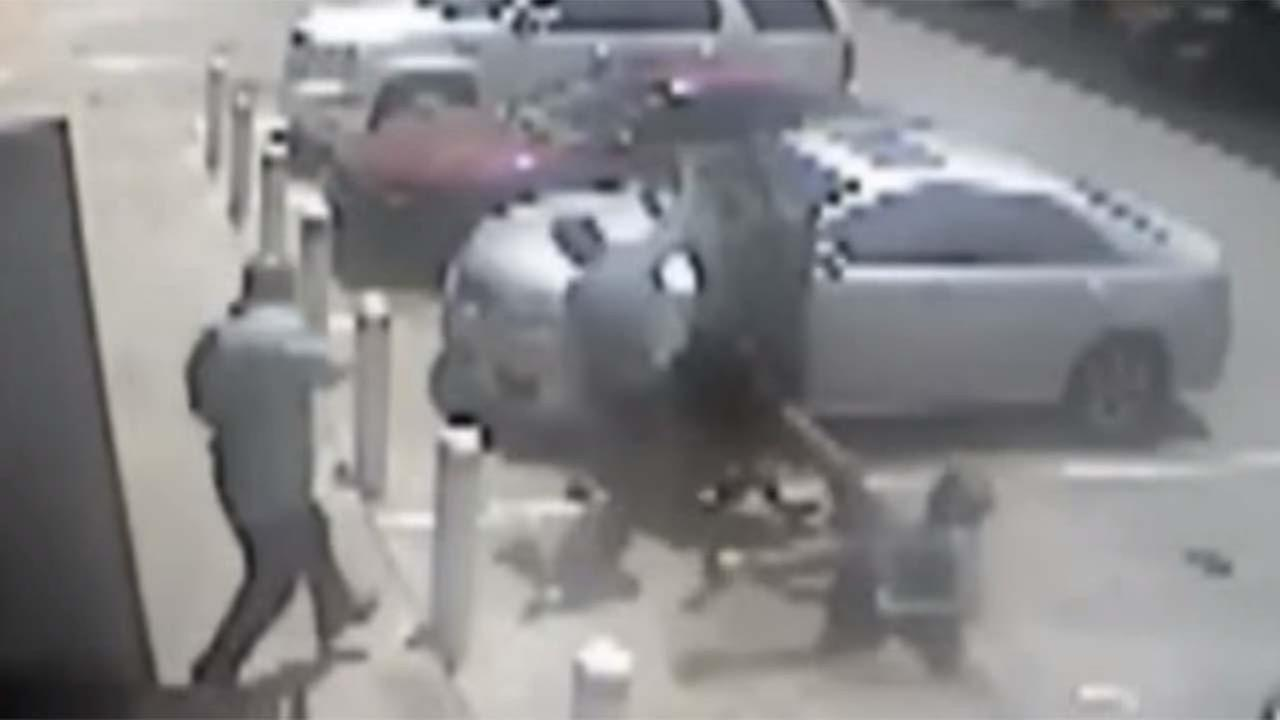 A still from a surveillance video showing mixed martial arts fighter Mayura Dissanyake fighting his co-workers attackers