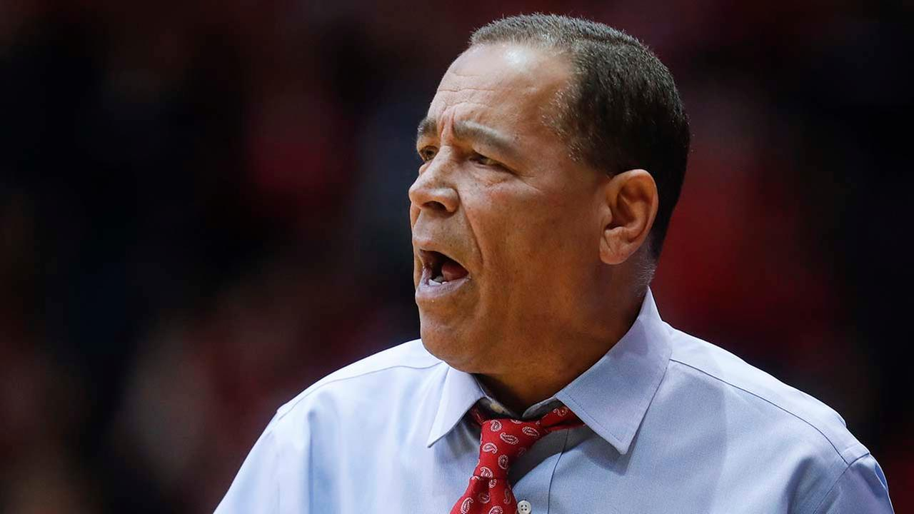 Houston head coach Kelvin Sampson directs his players from the bench in the first half of an NCAA college basketball game against Cincinnati.