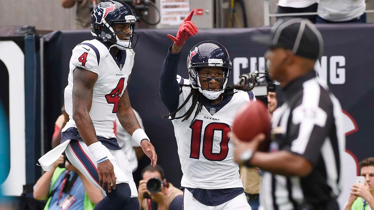 Houston Texans quarterback Deshaun Watson (4) celebrates with teammate wide receiver DeAndre Hopkins (10) after they connected for a touchdown.