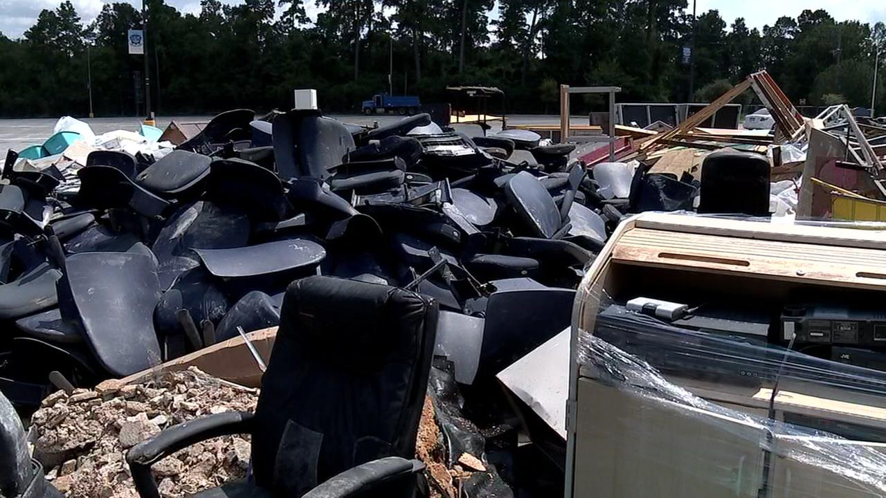 Office chairs were piled outside of Kingwood High School as the campus was cleaned out in the wake of Hurricane Harvey.