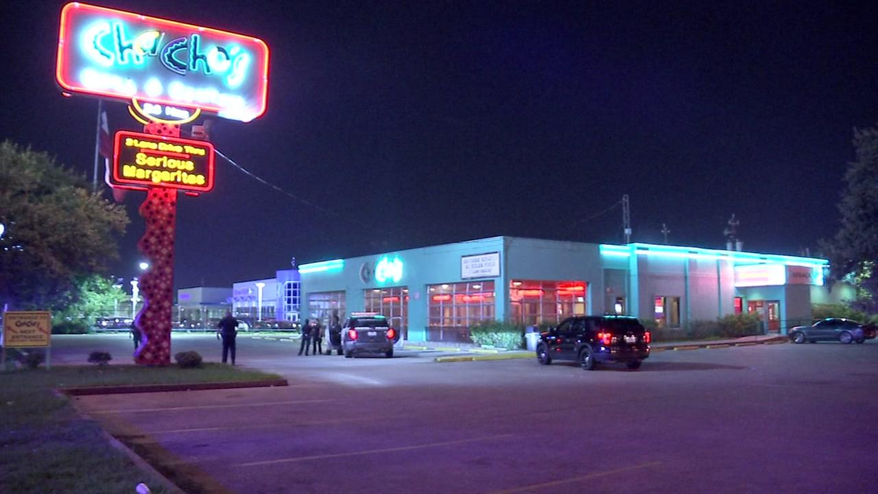 Angry customer opens fire on Chachos restaurant nearly hitting officers gathered in the parking lot.
