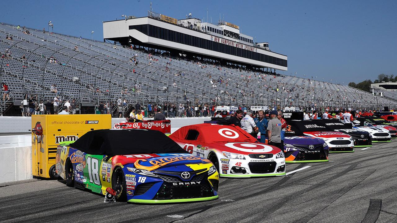 Race cars are lined up prior to the NASCAR Cup Series 300 auto race at New Hampshire Motor Speedway in Loudon, N.H., Sunday, Sept. 24, 2017. (AP Photo/Charles Krupa)