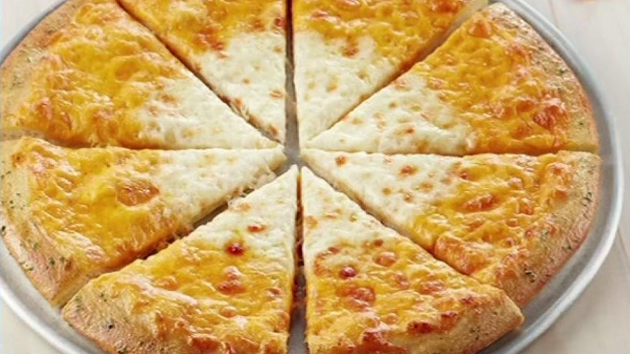 Chuck E. Cheese introduces new candy-corn inspired pizza.
