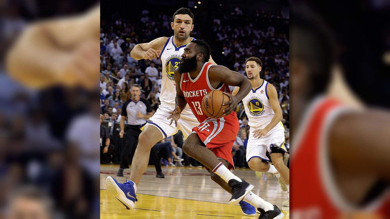 Houston Rockets James Harden drives the ball against Golden State Warriors Zaza Pachulia during the first quarter of an NBA basketball game Oct. 17, 2017, in Oakland, Calif.