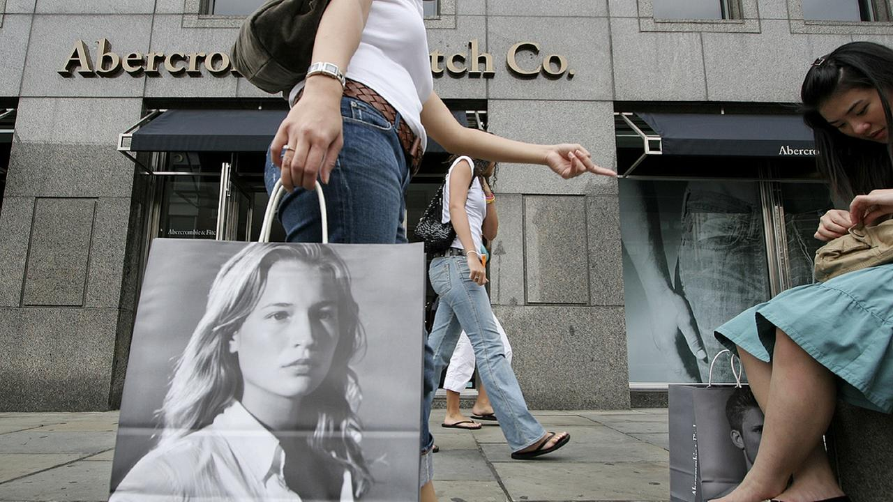 A shopper carries an Abercrombie and Fitch shopping bag after purchasing items in one of the companys New York stores.