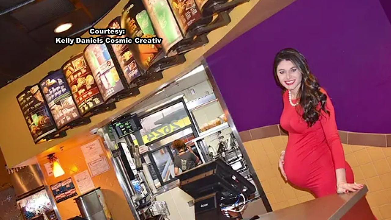 Woman shows off baby bump outside Taco Bell restaurant